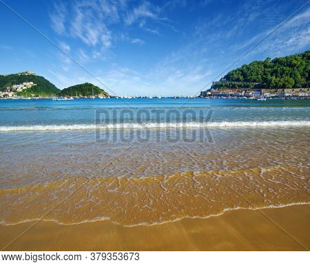 Sand beach and ocean in the town center of San Sebastian in Bay