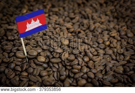 Cambodia Flag Sticking In Roasted Coffee Beans. The Concept Of Export And Import Of Coffee