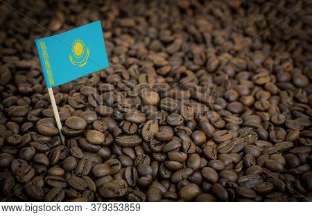 Kazakhstan Flag Sticking In Roasted Coffee Beans. The Concept Of Export And Import Of Coffee
