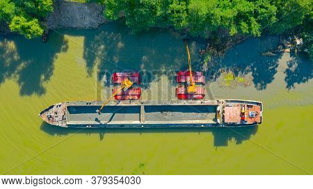 Aerial View On Excavator Dredge Is Dredging, Working On River, Canal, Deepening And Removing Sedimen