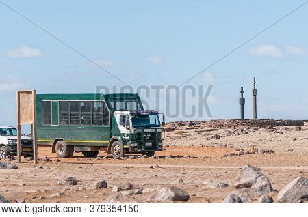 Cape Cross, Namibia - June 7, 2011: A Safari Truck With Two Replicas Of The Cross, Planted By Diogo