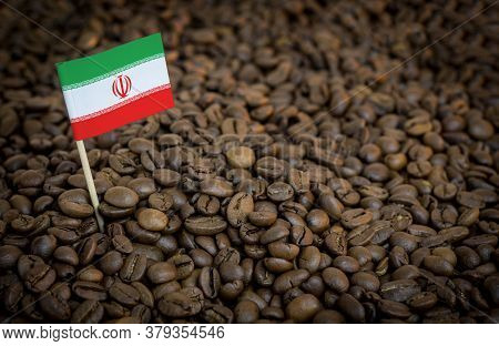 Iran Flag Sticking In Roasted Coffee Beans. The Concept Of Export And Import Of Coffee