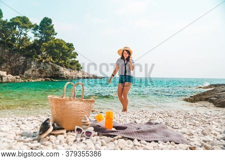 Beach Stuff Straw Hat And Bag With Flippers And Sun Protection Cream