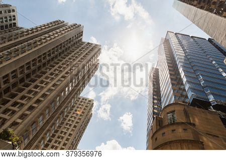 Hong Kong City Urban Architecture Background, Tall Modern Block Of Flats Are Under Cloudy Sky At Sun