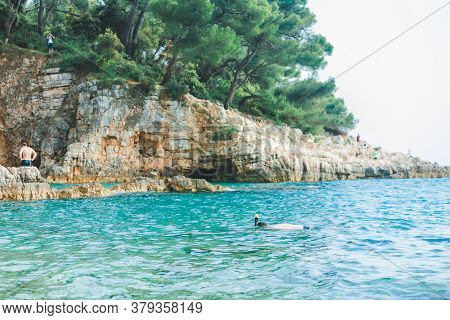 Man Swimming With Snorkeling Mask At Blue Azure Sea Water