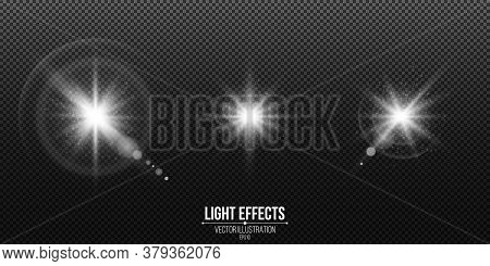 Set Of Shining Stars. Light Effects Isolated On A Black Transparent Background. White Glare And Flar