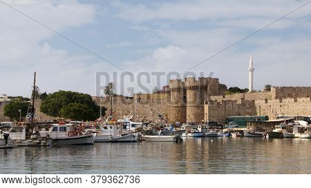 Rhodes, Greece - August 05, 2020: Marine Gate And The Fortifications Of The Old Town Of Rhodes, View