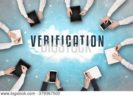 Group of people having a meeting with VERIFICATION insciption, web security concept