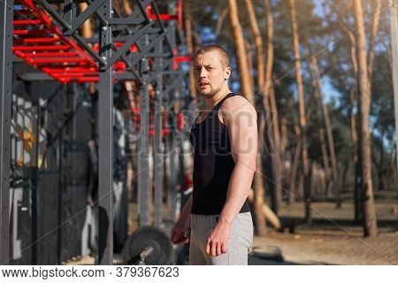 Athletic Man Standing Outdoor Gym Workout. Handsome Caucasian Guy Cross Training Nature Public Gym.