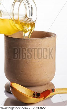 Honey In A Glass Jar, Scoop The Honey In A Glass Jar With A Wooden Spoon.