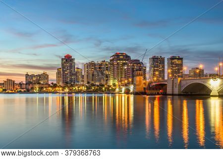 West Palm Beach, Florida, USA downtown skyline on the Intracoastal Waterway at dusk.