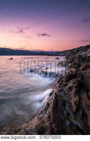 Rocky Coastline Of Corsica At Dawn