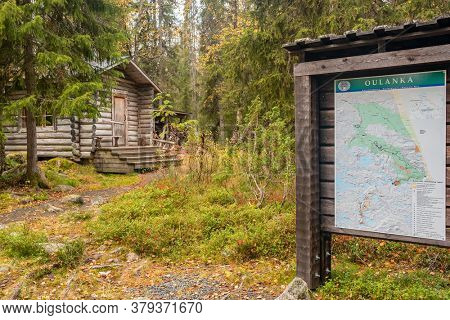 Lapland, Finland - September 22, 2019: Topographic map and traditional wooden wilderness hut, cabin cottage, in Oulanka national park, Lapland, Finland