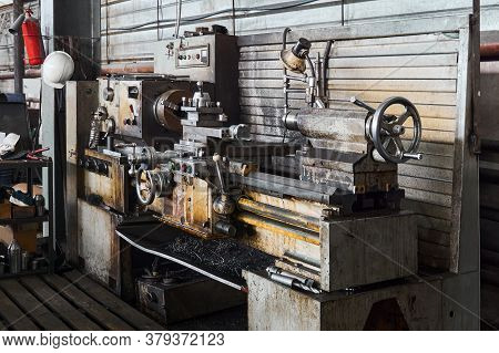 Workstation Of A Turner In A Workshop With A Lathe In The Foreground