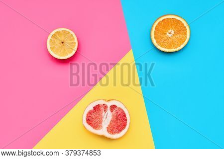Citrus Fruits On Abstract Geometry Colored Paper Texture Minimalism Background With Pastel Pink, Blu