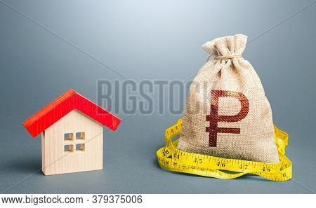 House And A Russian Ruble Money Bag. Calculation Of Expenses For Purchase, Construction And Repair.