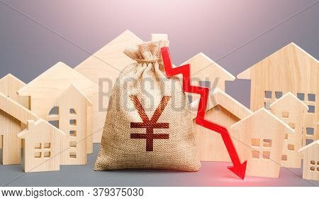 City Residential Buildings And Yen Yuan Money Bag With A Red Down Arrow. Low Cost Of Real Estate. Lo