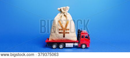 The Truck Is Carrying A Huge Yen Yuan Money Bag. Great Investment. Anti-crisis Measures Of Governmen