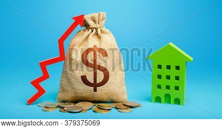 Dollar Money Bag With Red Up Arrow And Residential Building. Recovery And Growth In Property Cost. I