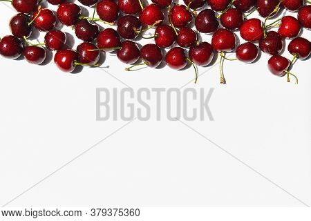 Ripe Sweet Cherries Frame On White Background With Copy Space