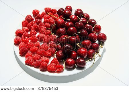 Mix Of Cherries And Raspberries On Plate Isolated On White Background. Summer, Vegetarian Concept