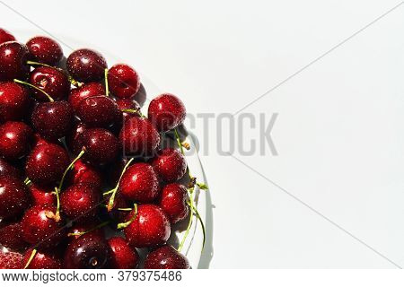 Ripe Sweet Cherries On Plate Isolated On White Background With Copy Space. Healthy Food, Summer Conc
