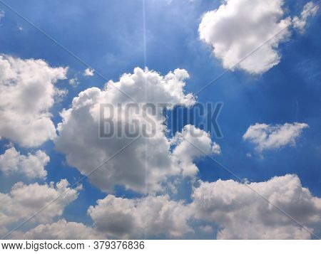 White Clouds And Blue Sky. Sunny Climate.nature. Daylight.
