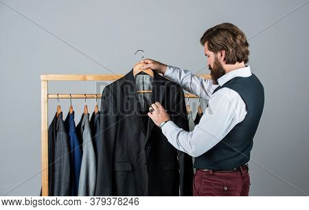 He Is An Expert Tailor. Individual Measures Hand Of Man. Man Ordering Business Suit Posing Indoor. T