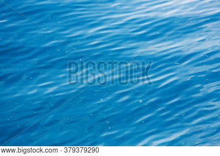 Abstract Turquoise Water Background. Rippled Sea Surface. Deep Blue Transparent Lake