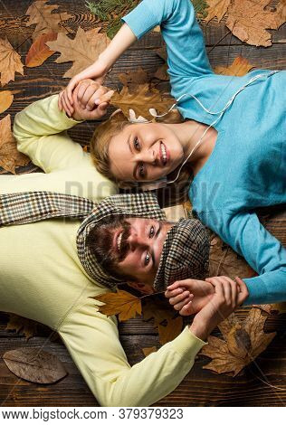 Happy Thanksgiving Day. Family Play In Autumn Leaves. Happy Couple In Love Lying On Fall Background.