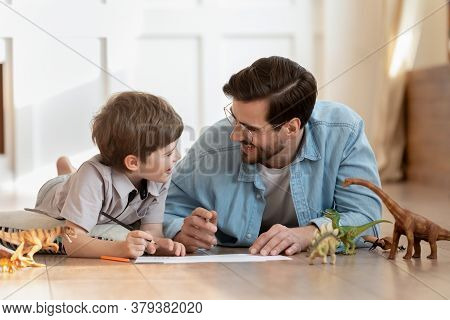 Emotional Positive Father Involved In Funny Domestic Activity With Son.