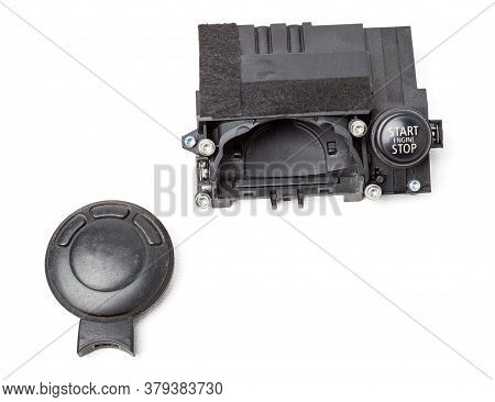 Electronic Ignition Lock Made Of Metal With A Key And A Button Made Of Black Plastic On A White Isol
