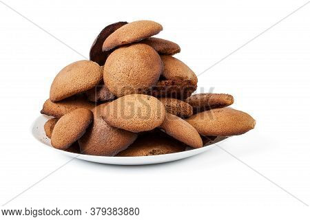 Brown Homemade Round Shape Cookies Lined With A Slide On A Plate On A White Isolated Background In A