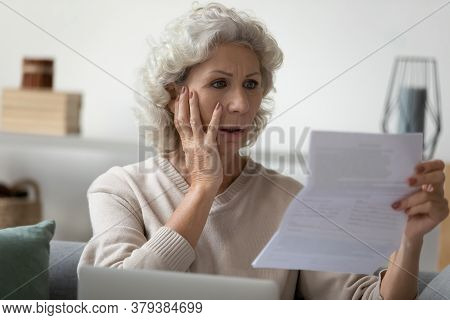 Senior Woman Reading Letter Feels Disappointed Having Financial Problems