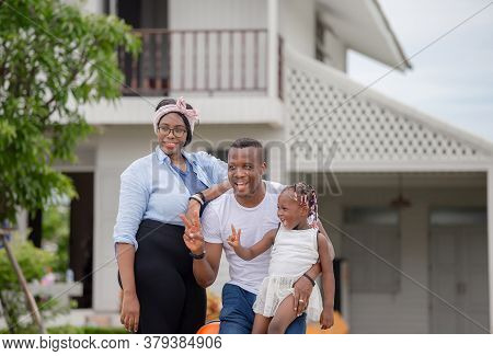 Cheerful African American Family With Luggage Leaving House For Vacation, Happiness Family Concepts