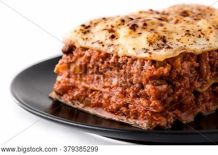 Piece Of Meat Lasagna On Black Plate Isolated On White Background. Close Up