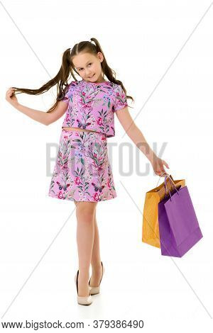 A Sweet Girl Straightens Her Hair. The Concept Of Fashion And Style. Isolated Over White Background