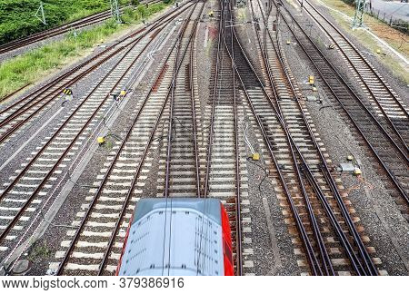 Multiple Railroad Tracks With Junctions At A Railway Station In A Perspective And Birds View