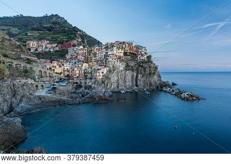 Beautiful Manarola Village Coastline In Cinque Terre, Italy At Sunset