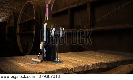 Row Of Vintage Wine Bottles In A Wine Cellar Shallow