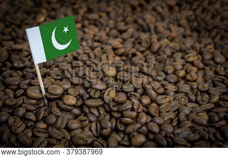 Pakistan Flag Sticking In Roasted Coffee Beans. The Concept Of Export And Import Of Coffee