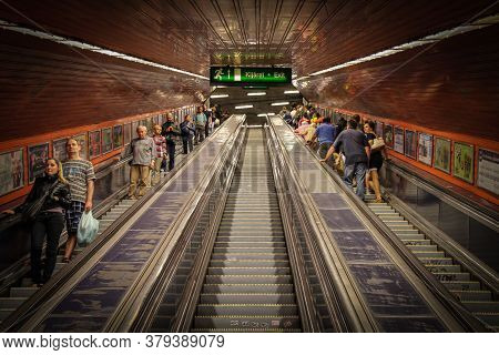 Budapest, Hungary - June 28th 2013: Ascending The Escalators In Budapest\'s Old Underground Metro, B