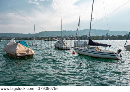 Boats, Sailing Yachts On Lake Zurich, Switzerland. Landscape. View Of The Opposite Bank With Houses