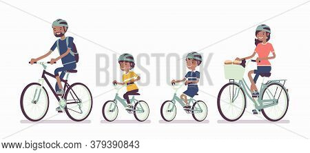 Happy Black Family Enjoying Bike Ride. Father, Mother, Son And Daughter Together In Sport Activity R