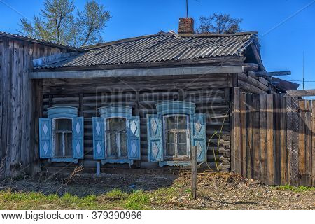 Wooden Architecture Of Siberia. Wooden Houses On Streets In The Center Of Irkutsk