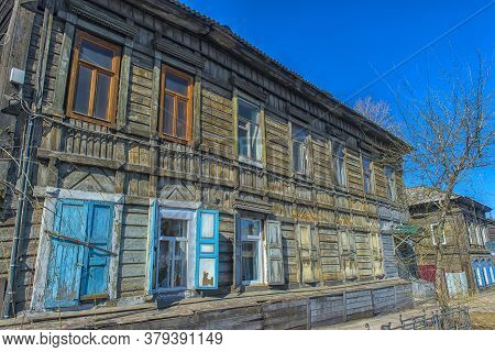 Russia, Irkutsk 06,05,2018 Wooden Architecture Of Siberia. Wooden Houses On Streets In The Center Of