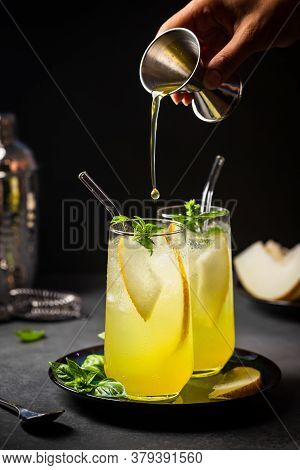 Melon Juice, Lemonade In Glasses With Ice And Melon Slices Garnished With Basil Leaves. Concept Of F