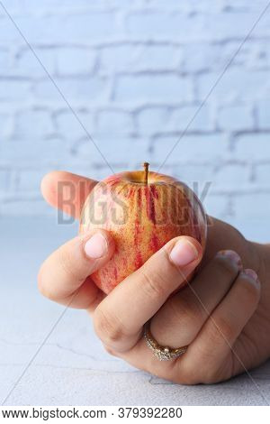 Red Ripe Apple On Women Hand, Isolated On White .