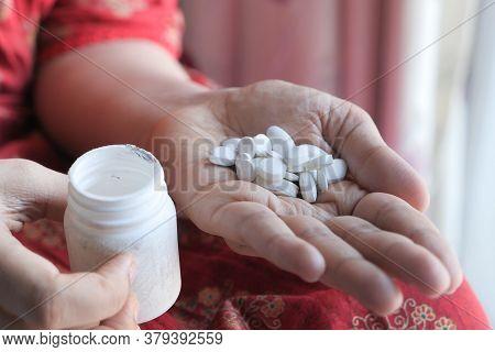 Close Up Of Women Hand Taking Pills