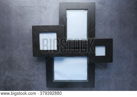 Top View Of Empty Frame On Black Background .